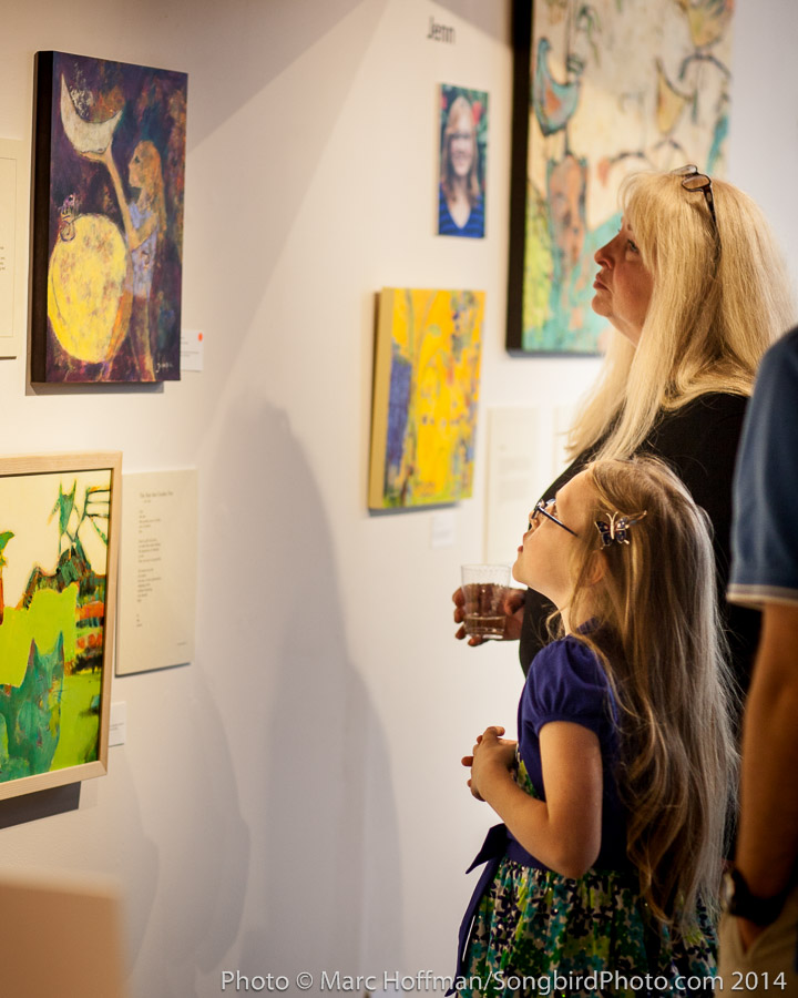 Gallery visitors consider the artwork of Jacqui Beck at the Kirkland Arts Center.