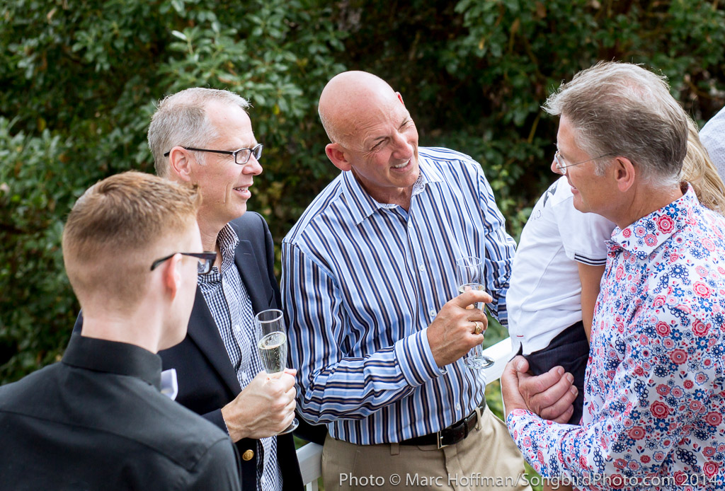 Male camaraderie at a summer wedding event.